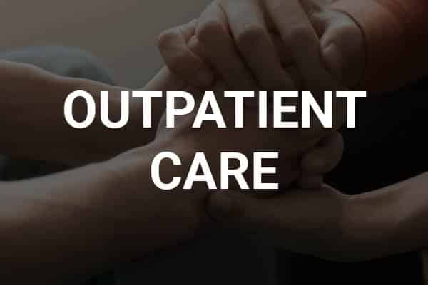 patient holding hand while receiving outpatient treatment