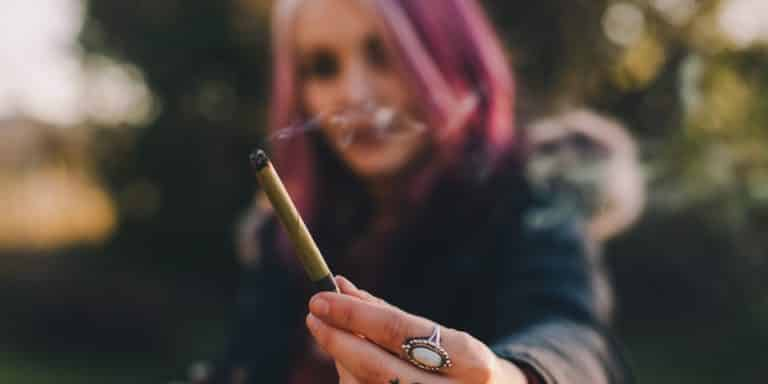 woman passing a blunt